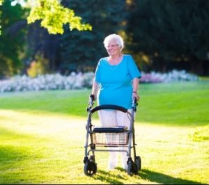 Elderly-lady-with-walker-in-sunny-garden
